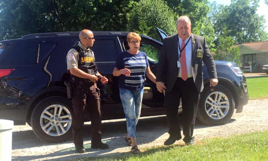 Sue Hodgkinson, under escort with the St Clair county sheriff's office.