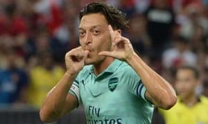 Arsenal's Mesut Özil celebrates after scoring.