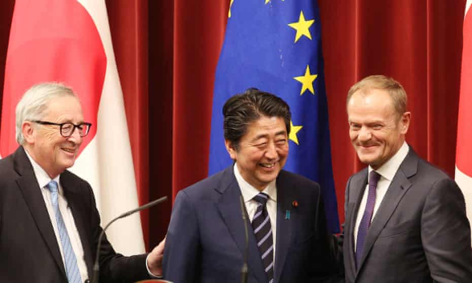 Jean-Claude Juncker (left), Shinzo Abe (centre) and Donald Tusk at a joint press conference in Tokyo