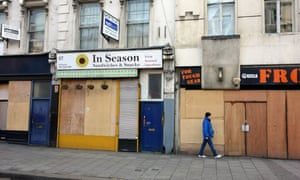 Row of empty shops to let in London.