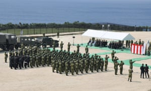 Members of Japan's military take part in the opening ceremony at the new base on Yonaguni island.