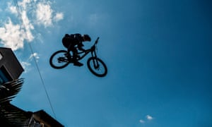 Mexican extreme mountain bike athlete Nicolas Cantu makes a jump during the Downhill Challenge Medellin 2018