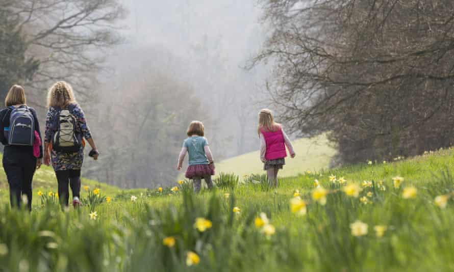 Visitors exploring the garden in springtime at Cliveden, Buckinghamshire