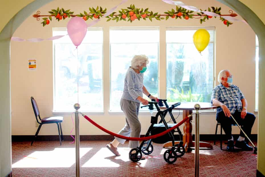 Seniors wait for their turn to receive their dose of Pfizer vaccine at the Mission Commons, a senior living community, in Redlands, California.