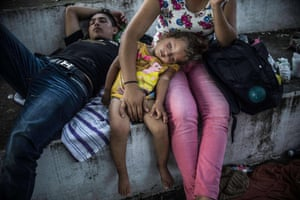 Honduran migrants taking part in a caravan heading to the US, rest during a stop in their journey, in Huixtla, Chiapas state, Mexico, on October 23, 2018.