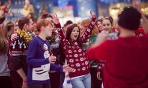 A group of people wearing Christmas jumpers in London
