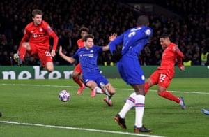Bayern Munich's Serge Gnabry slams the ball into the empty net.