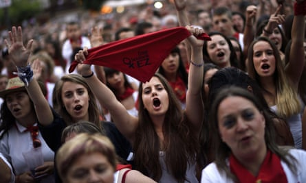 People protest against the surge in sexual attacks at the city's annual bull-running festival, in which 11 allegations of sexual assault were reported.