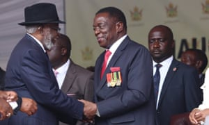 Emmerson Mnangagwa shakes hands with Sam Nujoma