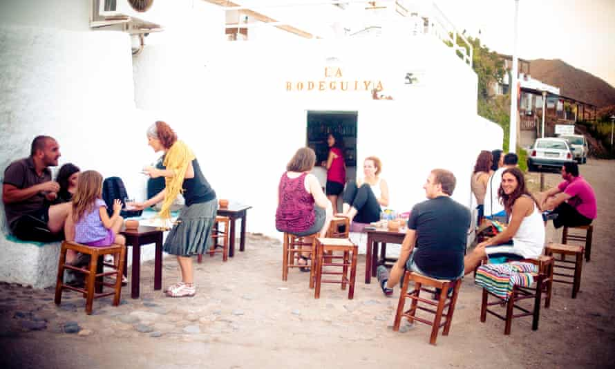 People outside a very typical, old-fashioned, whitewashed chringuito in las Negras, Cabo de Gata, Almeria, Andalucia