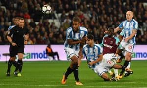 Pedro Obiang's shot deflects off Huddersfield defender Mathias Jorgensen and loops into the net.