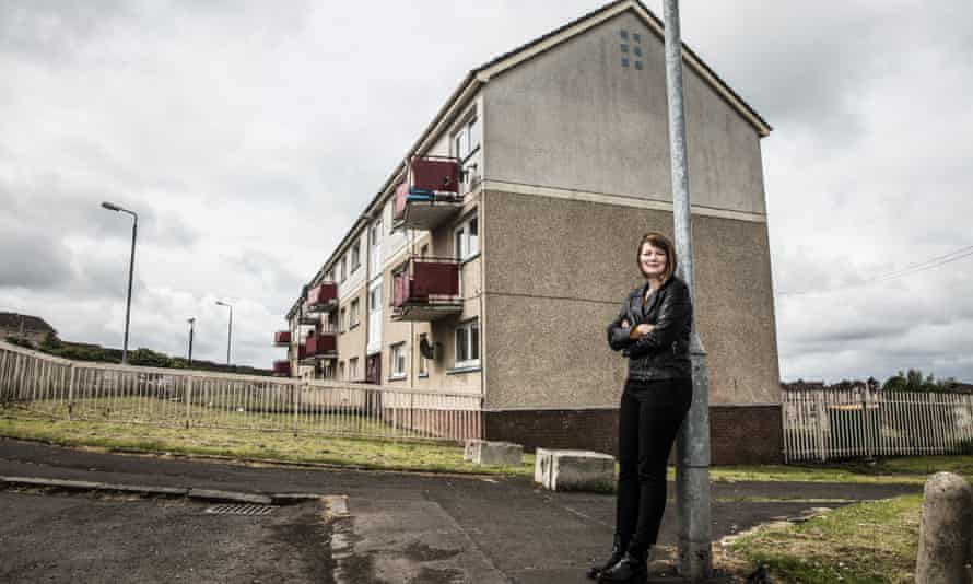 Author Kerry Hudson outside the council block where she used to live in Airdrie, Scotland.