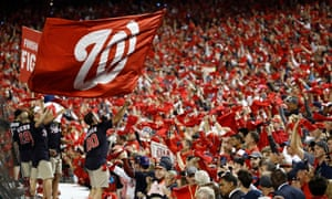 A Nationals flag is waved before the Washington Nationals played the Houston Astros in the World Series game three in Washington, DC.