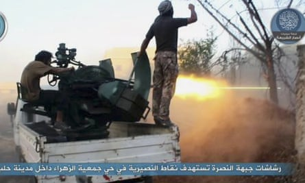 Fighters from the Khorasan group fire weapons against Syrian government forces in Aleppo on 7 July, in this image posted on the group's Twitter page.