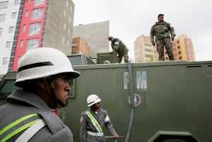 Military officers take part in the water distribution in La Paz