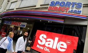 Shoppers walk past a branch of Sports Direct in Oxford Street, London.