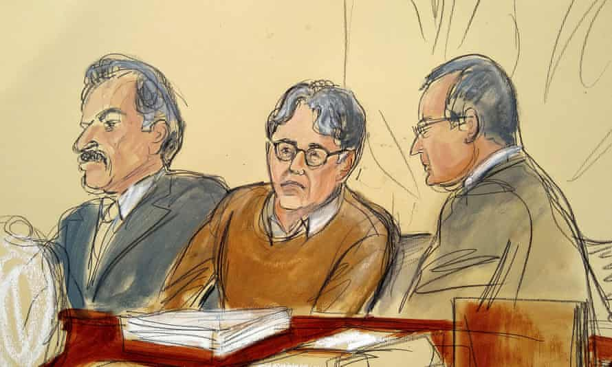 Keith Raniere, center, seated between his attorneys during the first day of his trial on 7 May.