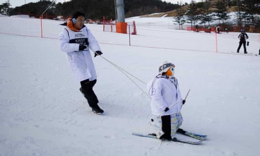 Robot TiBo skis during practice at the Ski Robot Challenge.