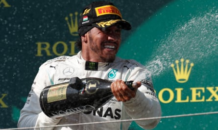 Lewis Hamilton celebrates winning the Hungarian F1 Grand Prix