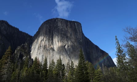 A rainbow is seen across the Yosemite Valley in front of El Capitan granite rock formation in Yosemite national park.
