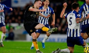 Diogo Jota turns and shoots through Lewis Dunk's legs to earn a 2-2 draw for Wolves at Brighton.