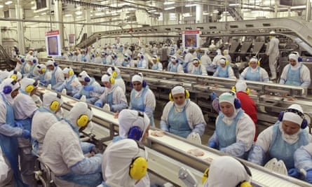 Workers at the JBS meat processing plant in Lapa, a city in the Brazilian state of Paraná