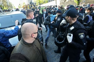 A police officer scuffles with a protester