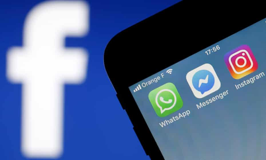 WhatsApp, Messenger and Instagram logos on a mobile phone