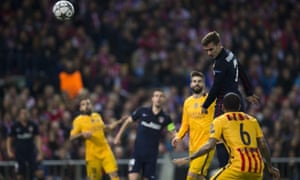 Atlético's Antoine Griezmann, right, heads the ball past Barcelona's goalkeeper Marc-Andre ter Stegen.