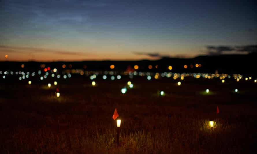 Lights and flags mark the spots where 751 human remains were recently discovered in unmarked graves at the site of the former Marieval Indian residential school on the Cowessess First Nation in Saskatchewan.