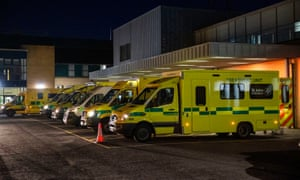 Ambulances at the entrance to the emergency department with patients awaiting to be admitted, at Antrim Area hospital in Northern Ireland.