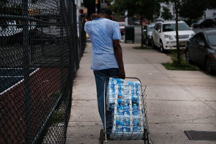 People wait in line for bottled water at a recreation center in Newark, New Jersey.