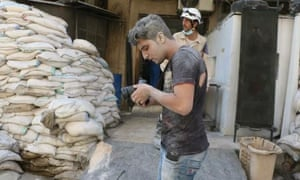 Young videographer Khaleed Khateeb, working in Aleppo on the documentary The White Helmets 2014