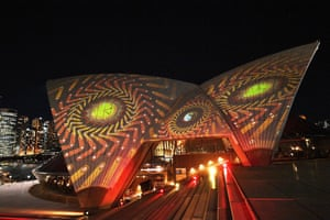 The Opera House sails are lit with art works by six female Aboriginal artists as part of 'Badu Gilli: Wonder Women' in Sydney on April 22, 2021.