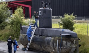 Officers board Peter Madsen's submarine UC3 Nautilus on a pier in Copenhagen in August.