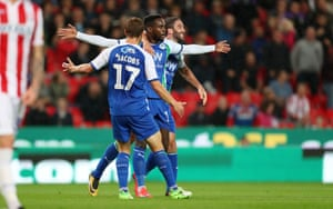 Gavin Massey of Wigan Athletic celebrates with his team mates after scoring.