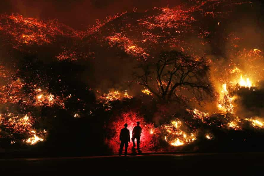 Photograph of firefighters monitoring a fire in California.