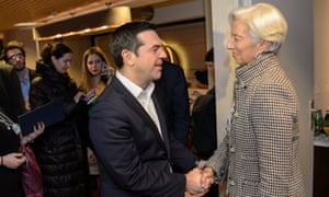 Greece's Prime Minister Alexis Tsipras (L) shakes hands with the Managing Director of the International Monetary Fund (IMF), Christine Lagarde (R) today.