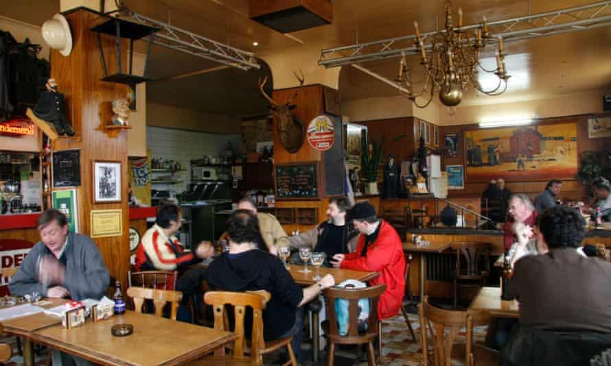 Customers at tables in La Brocante, Brussels, Belgium.