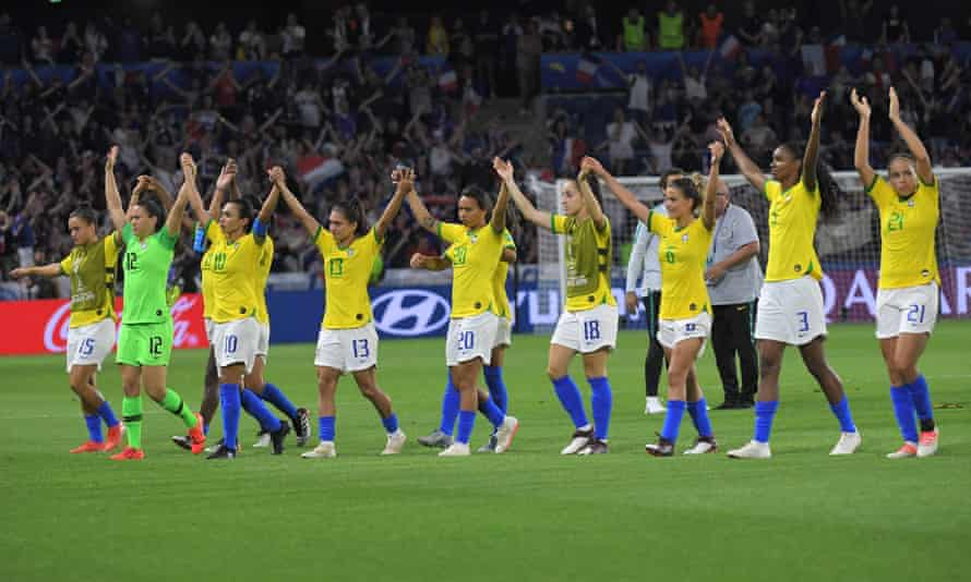 Brazil's players – led by Marta (10) – salute their supporters at the end of the match.