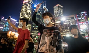 School students march at an anti-government rally in Hong Kong. Google announced YouTube was disabling 210 channels with content related to the protests.