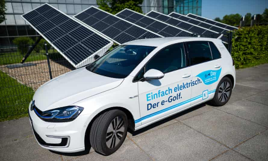 A Volkswagen e-Golf electric car stands in the front of the Volkswagen AG (VW) factory on May 8, 2018 in Dresden, Germany.