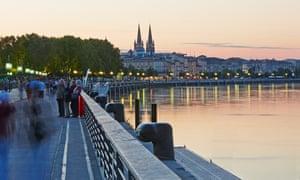 The Garonne River flows through Bordeaux at sunset.