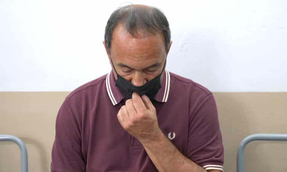 Domenico 'Mimmo' Lucano listens to court sentence in Locri, southern Italy, yesterday.