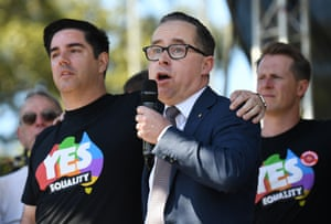 Alan Joyce, the CEO of Qantas, stands with his partner as he speaks at Prince Regent Park.