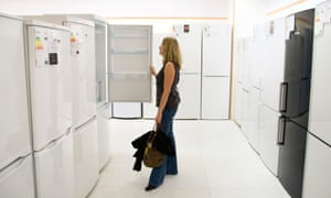 A woman looking at fridges in a shop