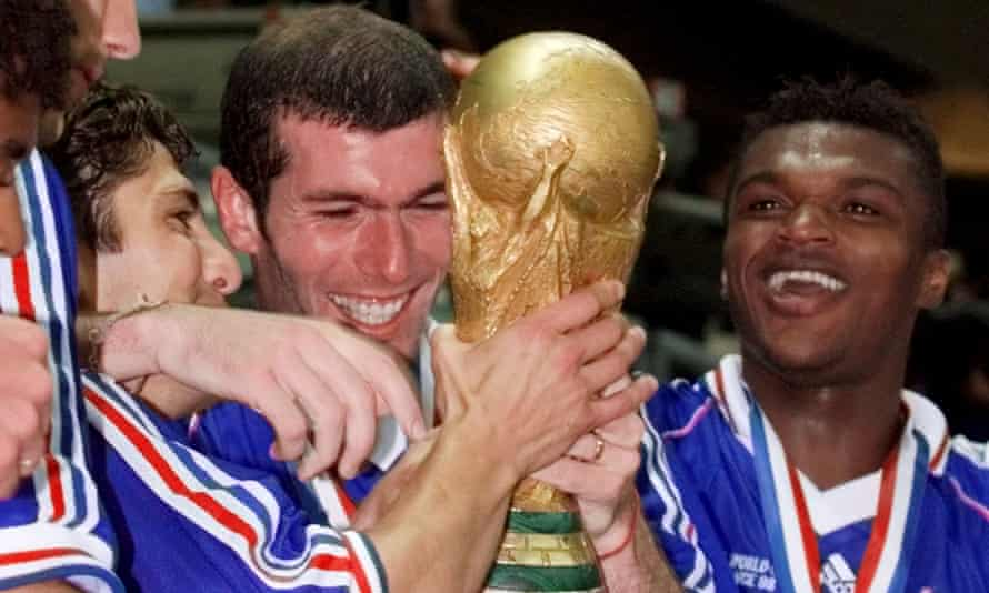 Zinedine Zidane and Marcel Desailly celebrate with the World Cup trophy.
