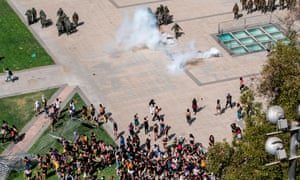 Riot police use tear gas against protestors in Santiago, Chile.