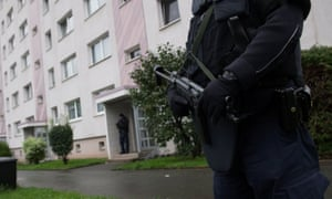 Police secure Albakr's apartment block in the town of Chemnitz in Germany