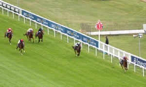 Love ridden by Ryan Moore (right) romps home to win the Investec Oaks.